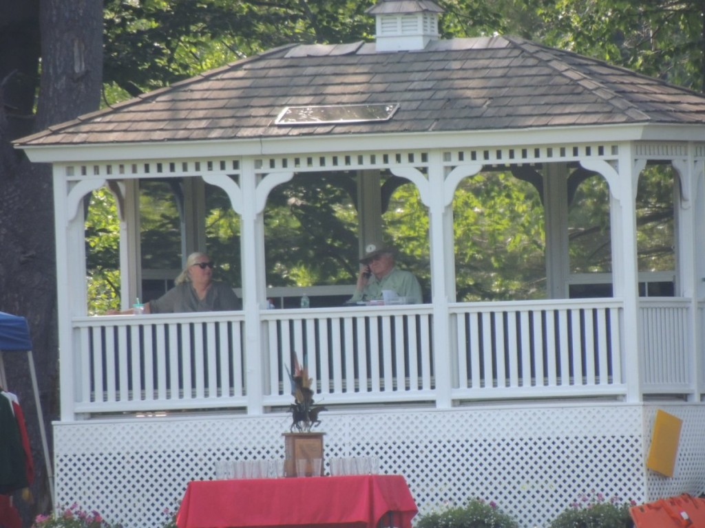 Couple in outdoor pavillion, man on mic