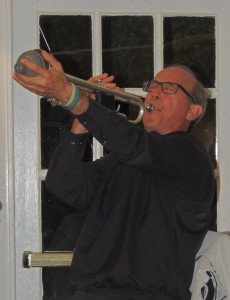 Bo Winiker, trumpet pointing up into the air