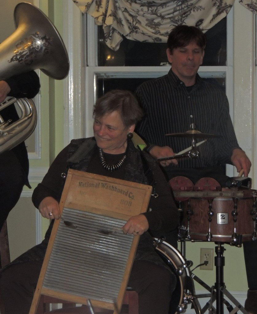 Caroline on washboard, with tuba and drum in background