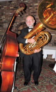 Stu holding tuba with string bass beside him