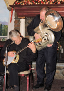 Jimmy banjo, Eli standing playing tuba