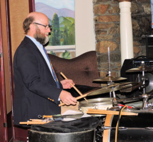 Malcolm tapping on snare drum