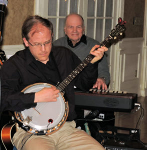 Eric on banjo with Phil keyboard in the back