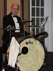 Bill with just bass drum, 1915 snare, and one smaller drum and 3 cymbals. No hi hat.