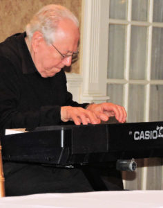Bob completely absorbed in playing keyboard