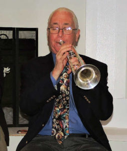 Phil Person blowing trumpet