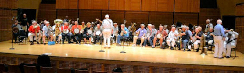 Carnegie Hall stage full of banjo players