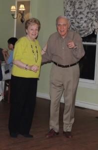 elderly couple swing dancing