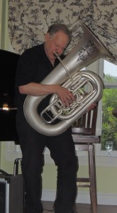 Eli standing, attacking the tuba like the old days at the Sticky Wicket.
