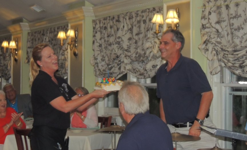waitress presents cake to Taddeo