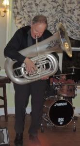 Eli stands playing tuba
