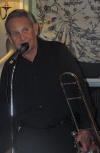 Herb singing into mic.