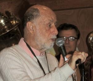 Joel at microphone
