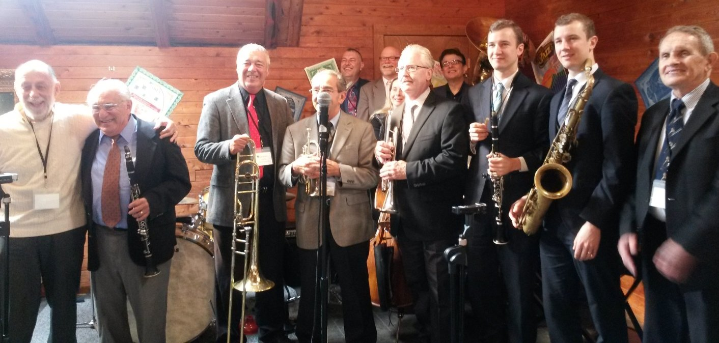 All musicians standing and smiling