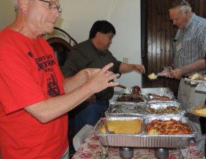 Dinner foods on warmers with volunteers