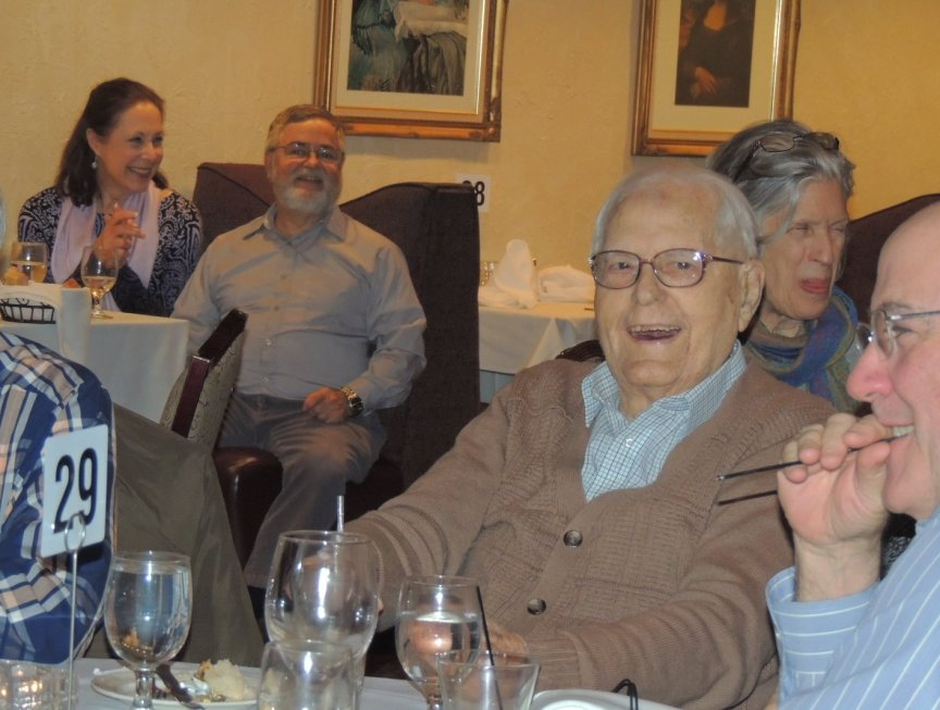 100 yr-old smiling and enjoying the music.  Band - Aid Ron L'Herault and friend in background.