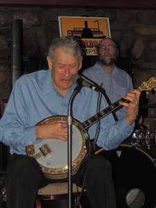 Jim singing and playing banjo