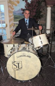 Steve Taddo beaming, on his antique Swingland drum set