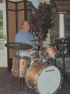 Dave with big smile on gold colored Ludwig drums