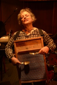 Caroline playing old washboard around her neck with spoons