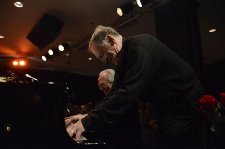 Eli and Bob playing four-handed piano