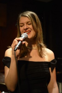 Rebecca in strapless black gown singing
