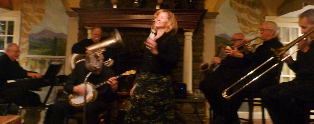 Sarah singing, with full band behind her