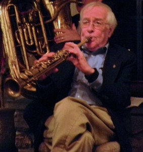 Stan sitting back, relaxed, playing soprano sax