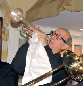 Bo with trumpet in the air holding a large handkerchief