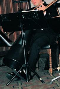 Dan holds megaphone with left foot