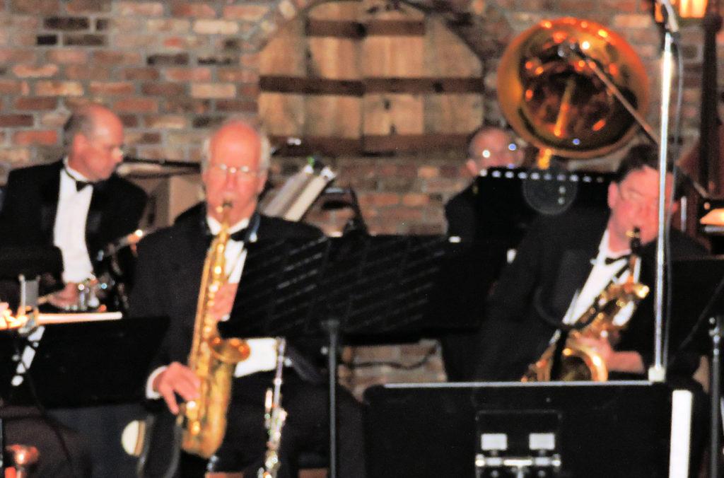 Billy Novick on alto sax, John Clark on baritone sax, Bill and Stu behind them