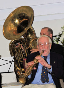 McDonald in front playing soprano sax, Gagnon behind him with huge tuba