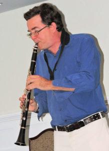 John in blue shirt on clarinet