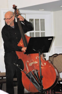 playing double bass and smiling