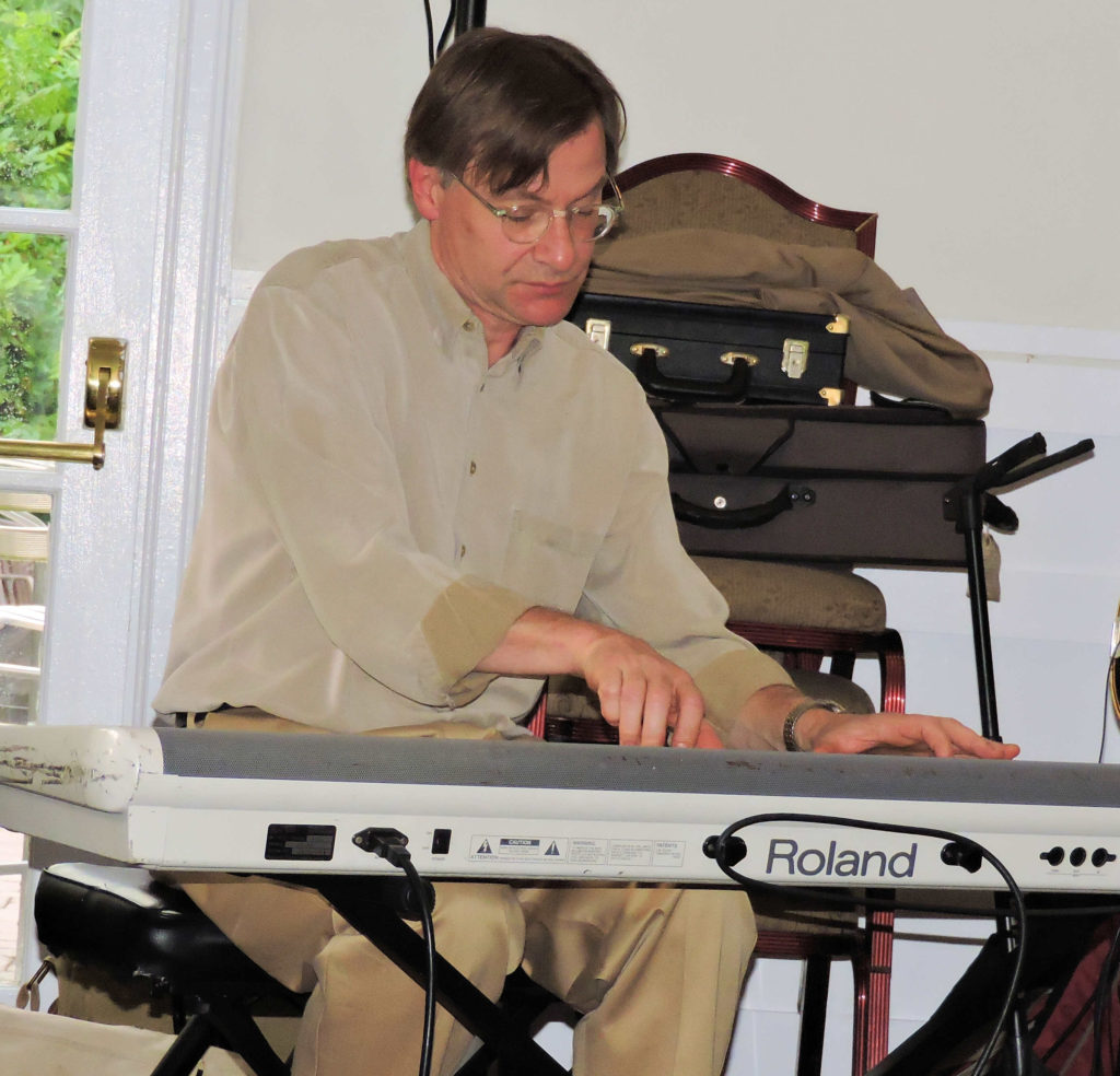 Ross playing stride on keyboard