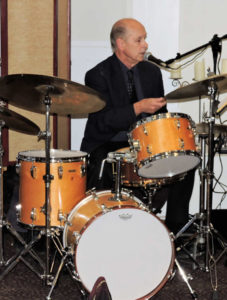 Bill Reynolds on drums and singing into mic