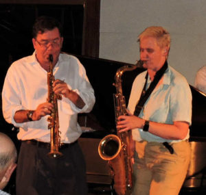 Clark on soprano, Sarah on tenor sax