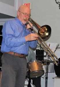 tom on open bell trombone