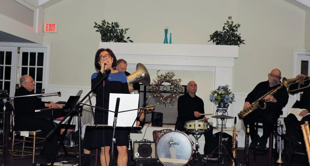 Elaine singing with the whole band