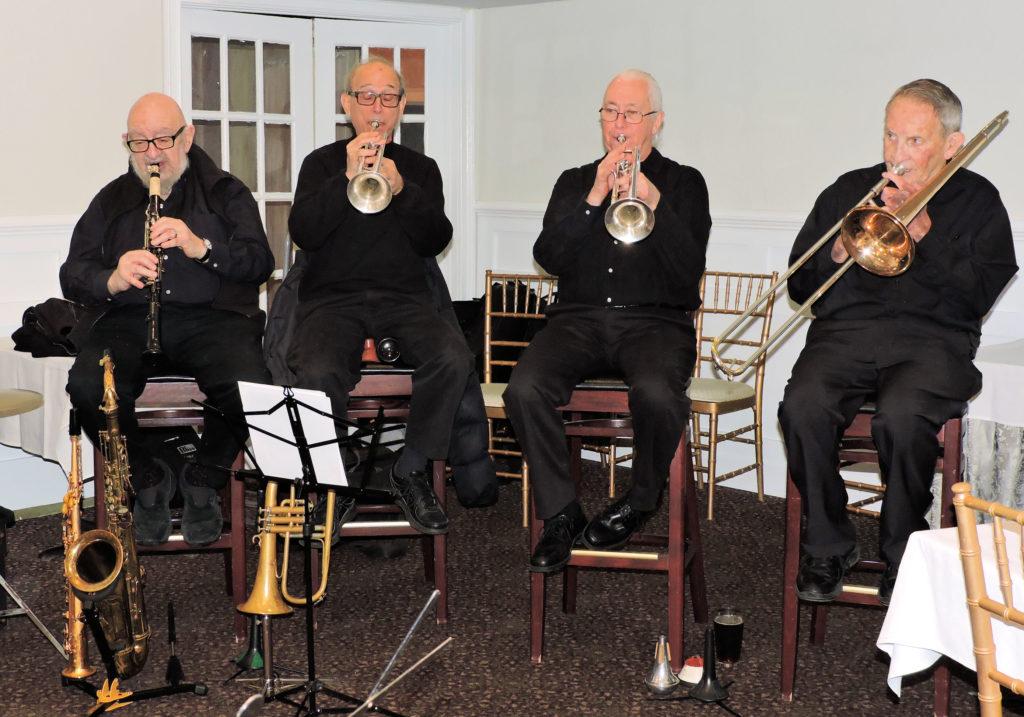 clarinet, two trumpets, trombone