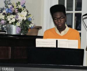 16 yr old African American on keyboard