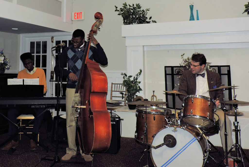 African-American 16 yr old pianist, his 19 yr old brother bass, and Dan Gabel (29?) drum and trumpet