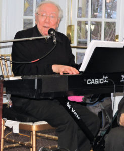 Keyboard player sings. Bob plays with the Boston Pops.