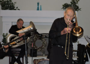 Herb up front on trombone with Eli on tuba behind him