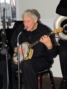 Jimmy playing banjo and singing